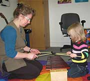 Brenda and Child playing Xylophone