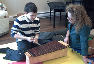 Brenda working with a child and a zylophone